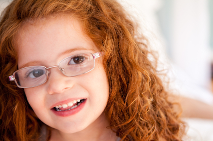 Smiling child with glasses.