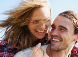 young man and woman laughing