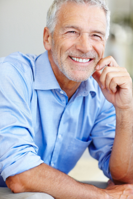 Man smiling with dentures from Dailley Dental Care